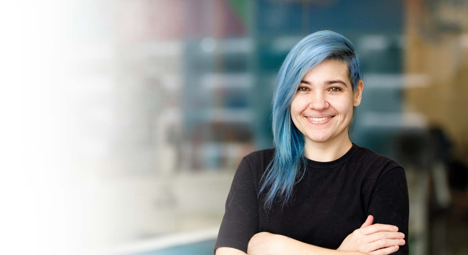 Young woman with blue hair smiling