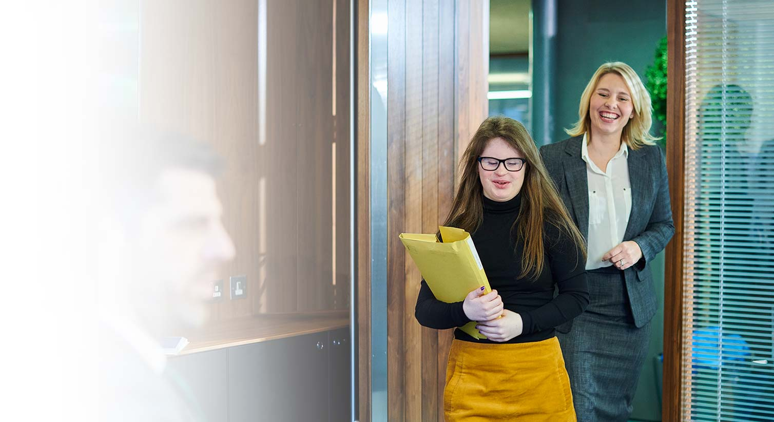 Young woman with a down syndrome leaving the office
