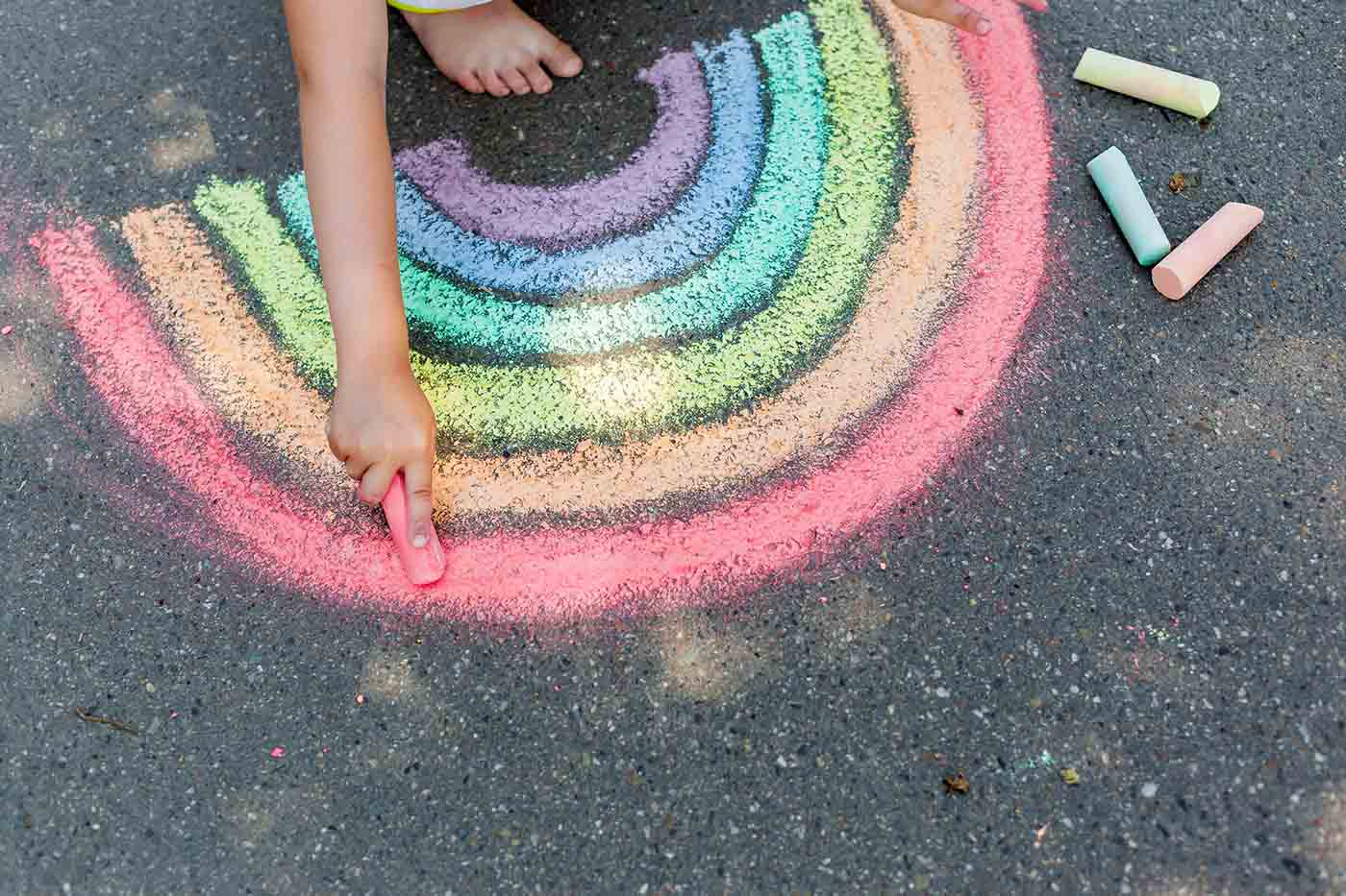 Chalk painting of a rainbow on the concrete