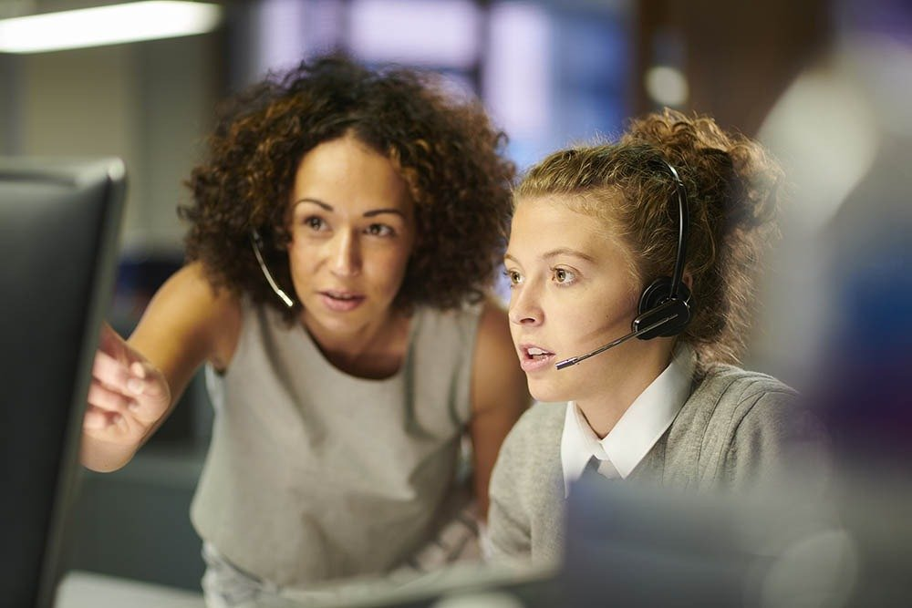 young woman training in a call center