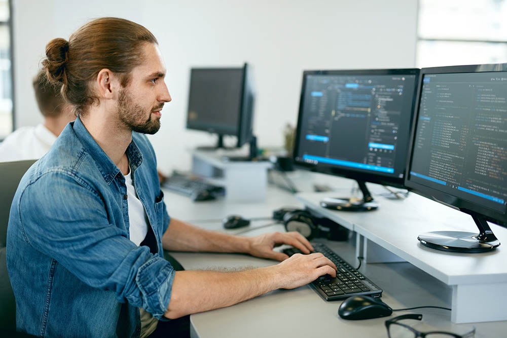 Young man coding something